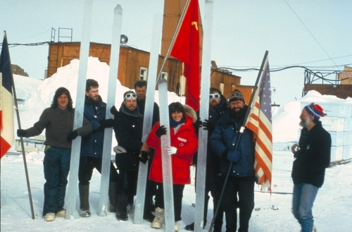 Science demands cooperation. By working together, these French, Russian, and American scientists were able to accomplish their goal: the long segments of ice they so proudly hold symbolize this sense of cooperation. Just as researching the Earth's climatic history requires collaboration between different individuals and different nations, preparing scientific, political, and social solutions for Earth's climatic future demands a level of cooperation far beyond that currently existing. While different nations and different peoples draw lines of separation and division on the globe, we all must realize that we share one, single planet, and that its destiny, good or bad, is the destiny of us all.